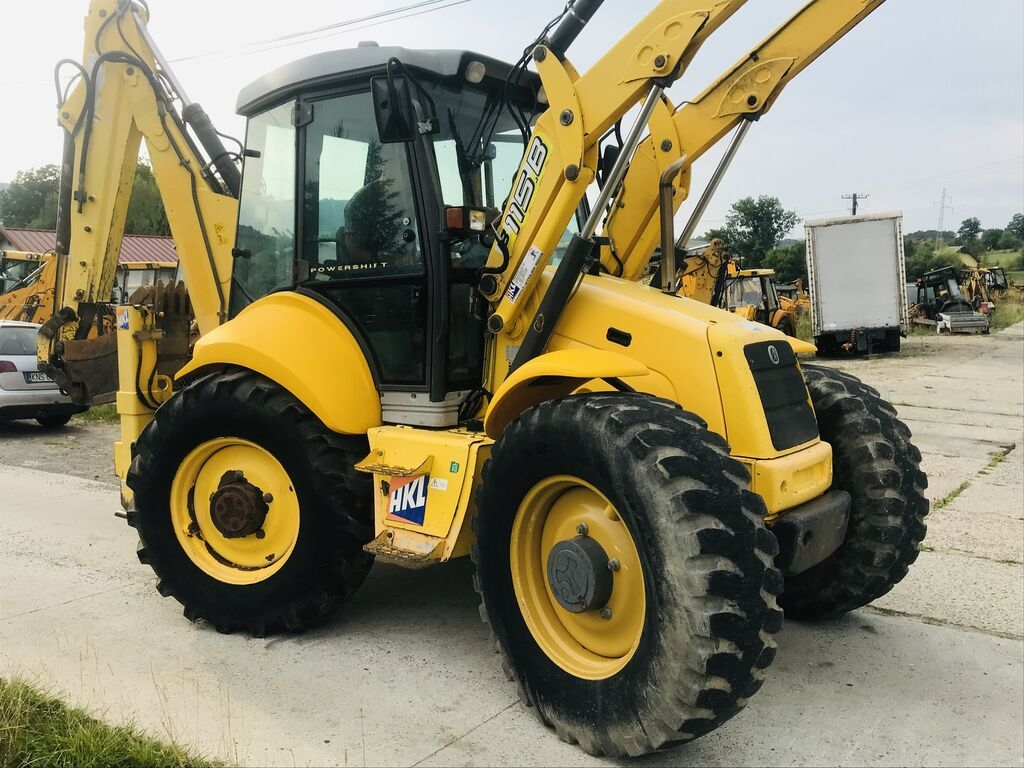 NEW HOLLAND LB 115 rendegraver
