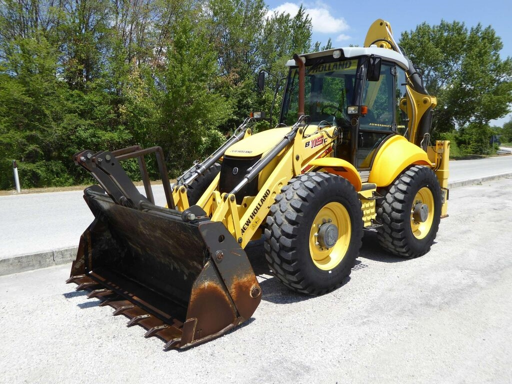 NEW HOLLAND B 115C rendegraver